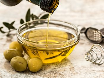 online health food stores pouring olive oil